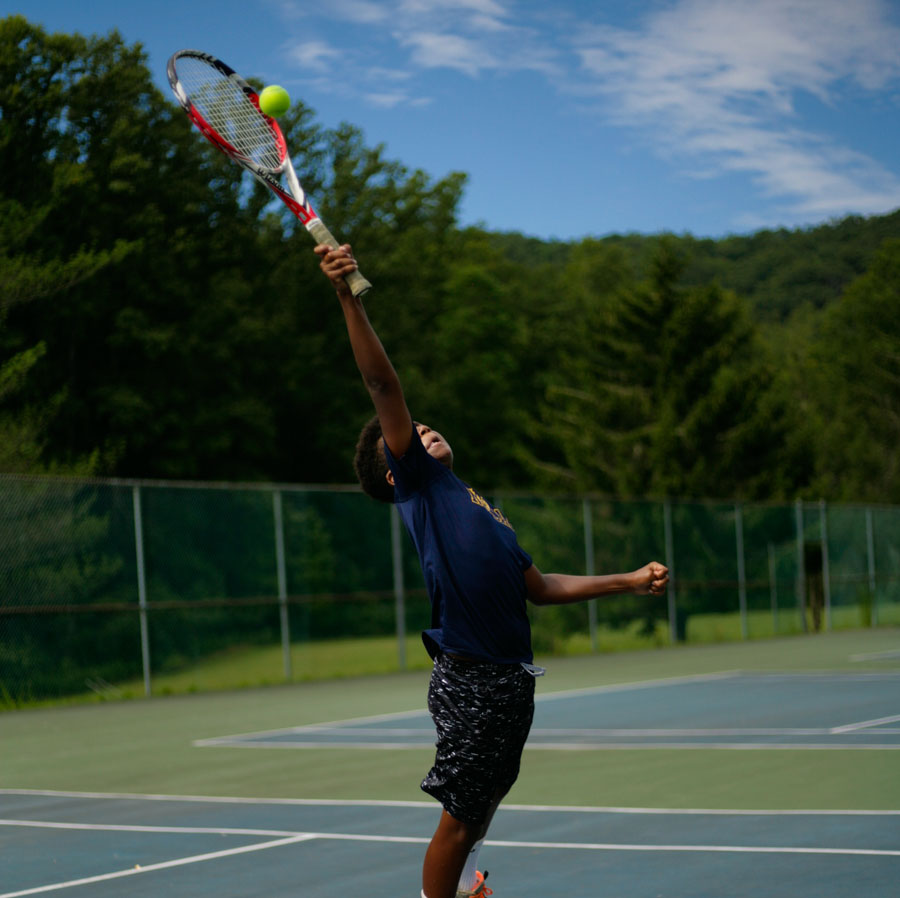 kid_playing_tennis.jpg